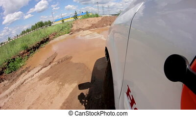 Point of view white crossover drives aling offroad