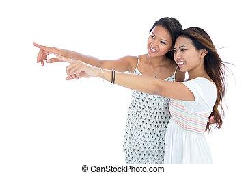 pointage, deux, jeune, asiatique, joli, femmes