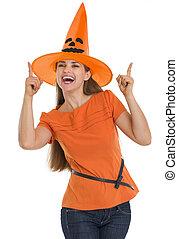 pointage femme, halloween, jeune, haut, chapeau, heureux