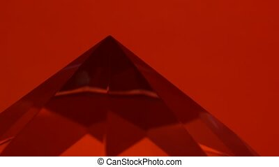 Pointed end of the diamond turns and shimmers. Red...
