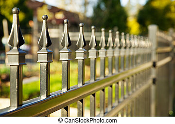 Pointed metal fence perspective with a narrow depth of field