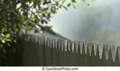 Pointed Wooden Fence - Steady, sharp angled, medium close up...