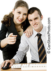 Pointing At Camera - A young businessman and woman looking...