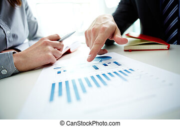 Pointing at chart - Image of male hand pointing at business...