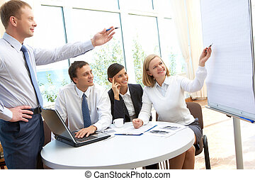 Pointing at whiteboard - Image of business partners pointing...