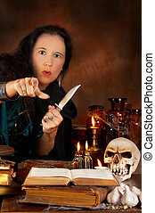Pointing at you - Halloween witch holding a knife and...