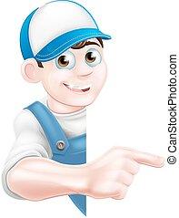 Pointing cartoon tradesman - Cartoon mechanic, plumber, ...