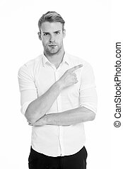 Pointing direction. Man shop assistant pointing index finger isolated on white. Manager or assistant help find direction. Guy handsome shows direction. Look at this advertisement. This way concept