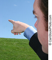 Pointing into distance - Business man pointing off into the ...