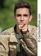 Pointing Latino Male Soldier