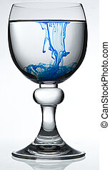 Poisonned water - wine glass on white background filled with...