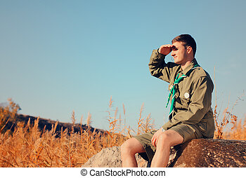 pojke, åskåda slut, sittande, fält, scout, vagga