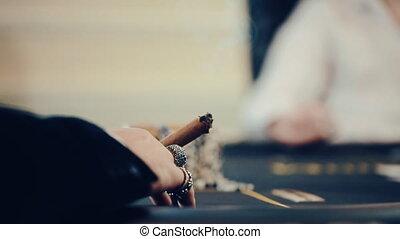 poker, a man Smoking a cigar, a player is nervous