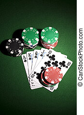 Poker cards and gambling chips on green background