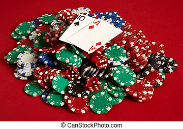 Poker cards and gambling chips on red background