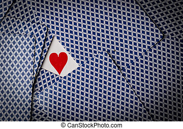 poker cards with a heart showing