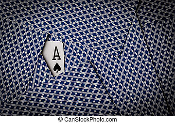 poker cards with ace of spades showing