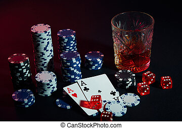 Poker cards with cubes are beautifully placed on the table, against the background of poker chips