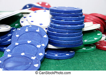 Poker Chips 01 - Poker chips and cards on a green felt top...