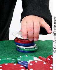 Poker Chips 03 - Poker chips on a green felt top table being...