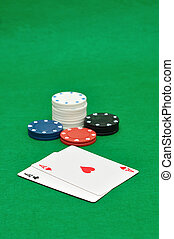Poker chips and 2 aces