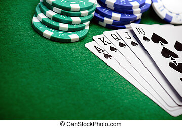 Poker chips and a straight flush card hand