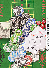 Poker chips, money, playing cards and dice