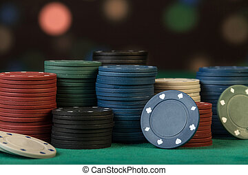 Colorful poker chips on black background close up