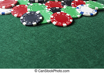 Poker Chips on Green Felt - Poker chips on green felt with...