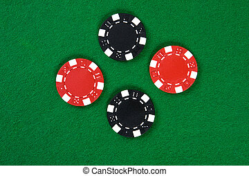 Poker chips - Two kinds of poker chips in the middle of...