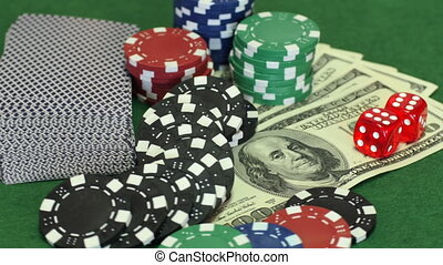 Poker collection on table - One hundred dollar bills, deck...