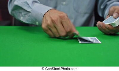 croupier distributes cards