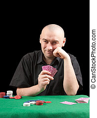 Poker gambler in black shirt in casino.
