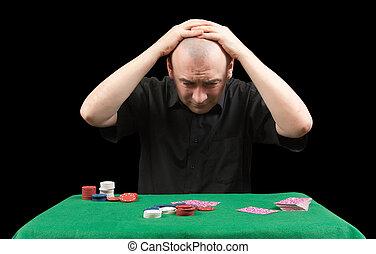 Poker gambler in black shirt. Losings. Isolated over black