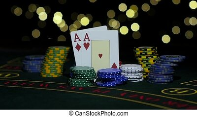 Poker gambling. Poker Chips and Two Aces. Close up. Slow motion