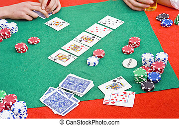 Poker game - A poker game in progress with a big flop