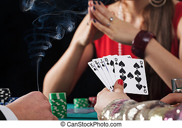 Poker game in casino - Poker game with drinks and cigarettes...