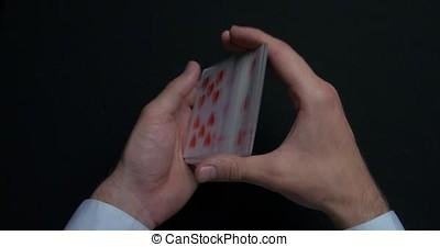 Poker game - shuffling cards. Man's hands shuffing cards....