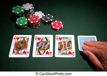 Poker hand royal flush win close up of cards with chips on...