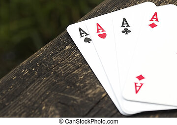 Poker of aces. Side view