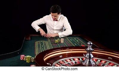 Poker player. Black - Poker player, losing in the casino,...