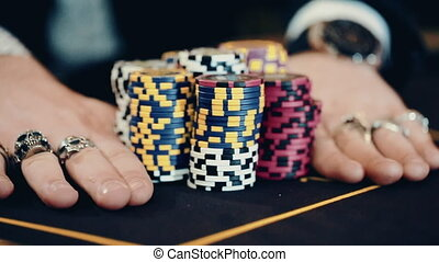 Poker player goes all-in. Concept of gambling, risk, win, fun, and entertainment