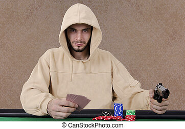 Poker player pointing gun