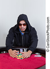 Poker player rakes in winning chips