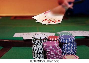 poker player showing royal flush