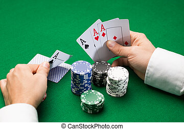 poker player with cards and chips at casino - casino, ...