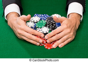 Successful Player Betting Chips At Casino And Hold Em Poker Cards On The Table Games And Gambling Concept Canstock
