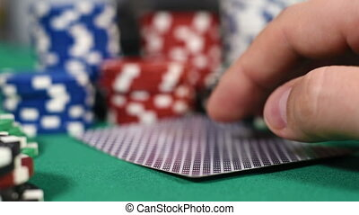 Poker Players Checking Cards, Holding Two Aces. Slow Motion...