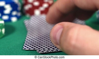 Poker Players Checking Cards, Holding Two Aces