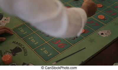 Poker players making bets close up. Risky game.